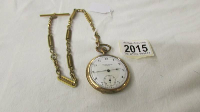 A Thos. Russell & Son, Liverpool gold plated pocket watch on chain.
