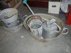 A quantity of galvanised buckets, baths, watering cans etc.