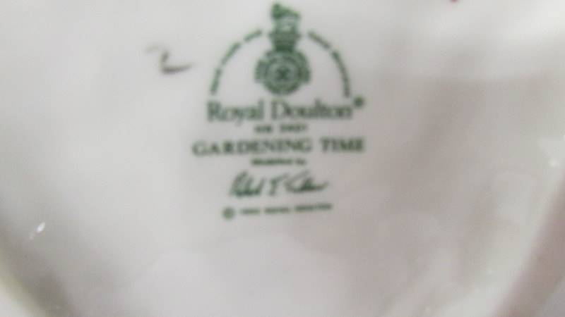A Royal Doulton figurine - Gardening Time HN3401. - Image 3 of 3