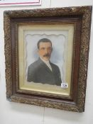 An early 20th century portrait of a man in original frame.