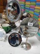 Four vanity mirrors.