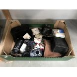 A box of old cameras,