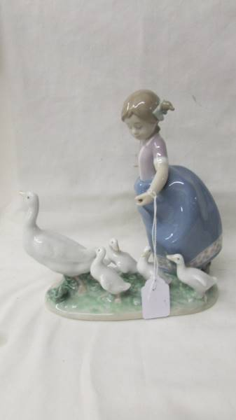 A Lladro girl with ducks and a Lladro girl with a chicken. - Image 2 of 3