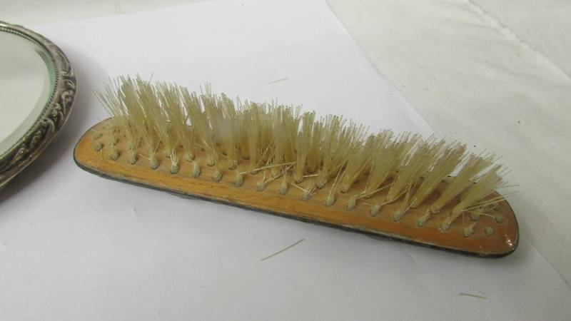 A silver backed hand mirror and two silver backed brushes, (one brush a/f). - Image 8 of 8