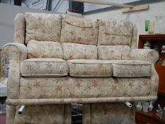 A three piece suite in good condition.