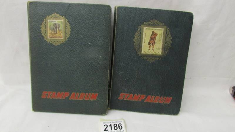 Two small albums of world stamps including India, China, Canada, UK etc.