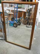 A framed bevel edged mirror.