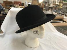 A Dunn & Co bowler hat,
