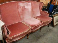 An old mahogany framed three seater sofa.