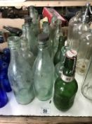 A large lot of clear 'local area' bottles