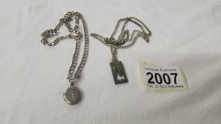 A silver locket on chain and a silver cat pendant on chain. 28.4 grams.