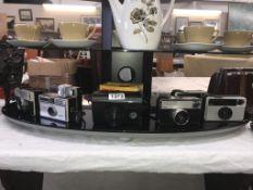 7 Kodak 126 instamatic cameras varying in age