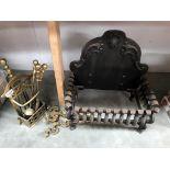 A cast iron fire grate & brass fire tools