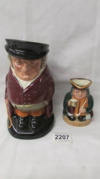 A Royal Doulton traditional Toby Jug The Huntsman and a smaller example Honest Measure.