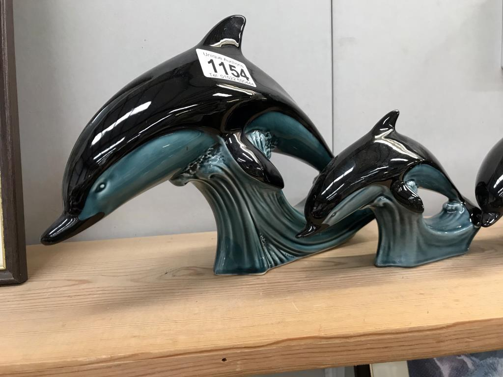 A large Poole dolphin & 3 smaller dolphins (1 base A/F) - Image 2 of 4