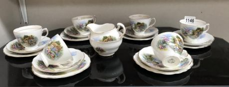 A Royal Vale thatched cottage decorated tea set