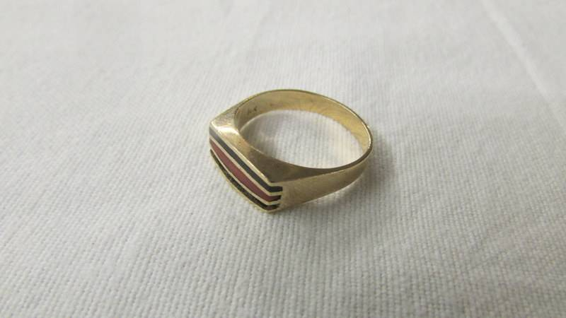 A 14k gold ring, size P. 4.4 grams.