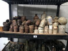 A shelf of brown/white stoneware