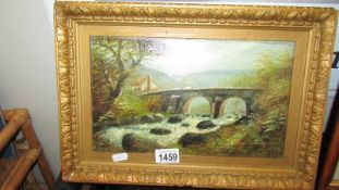 A late 19th century British school oil on board cottage by stone bridge with rushing water in
