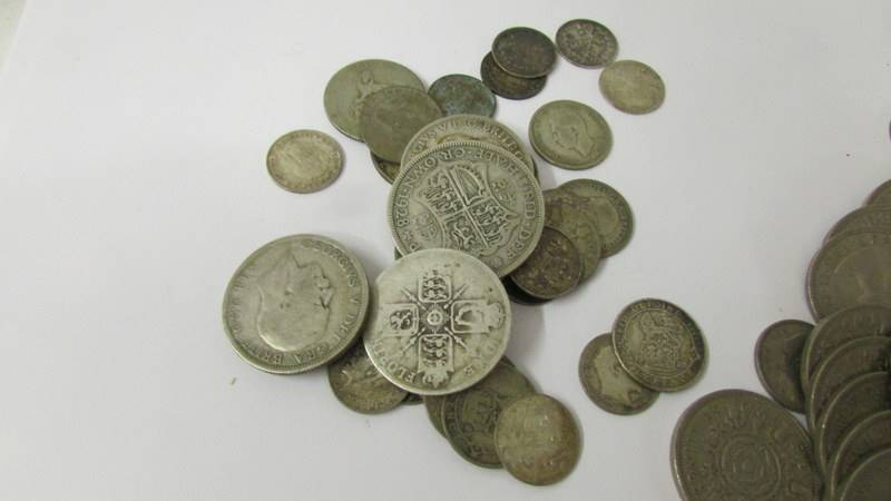 A mixed lot of coins including 110 grams of silver. - Image 2 of 3