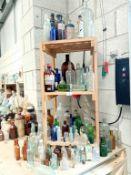 3 shelves of decorative bottles,