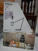 A boxed chocolate fountain and a boxed table lamp.