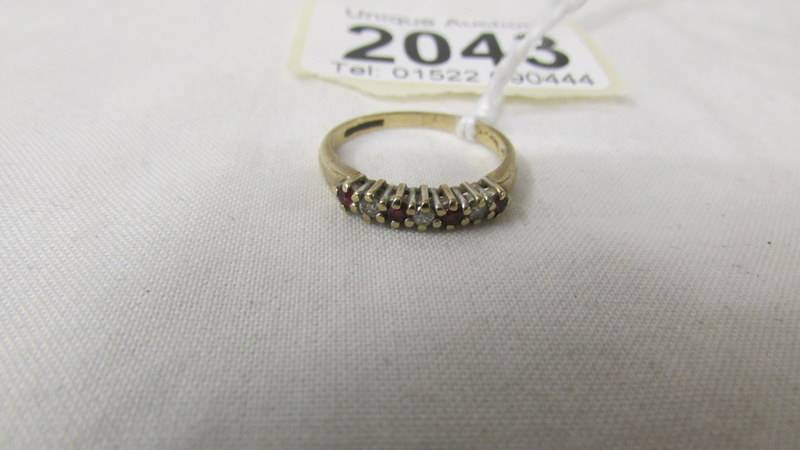 A 9ct gold diamond and sapphire ring, size J. 1.5 grams. - Image 2 of 2