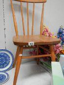 An Ercol dining chair.