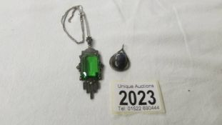 An early 20th century silver pendant set large green stone and another silver pendant.