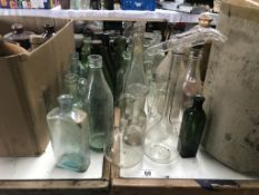 A lot of clean glass bottles many with maker's names