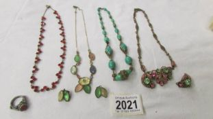4 vintage necklaces (2 with matching earrings) and a vintage ring.