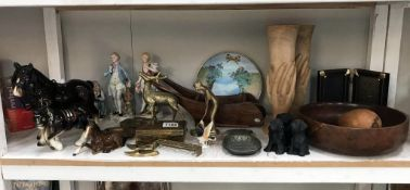 A large shelf of miscellaneous including brass,