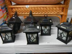 A quantity of plastic wall lanterns.