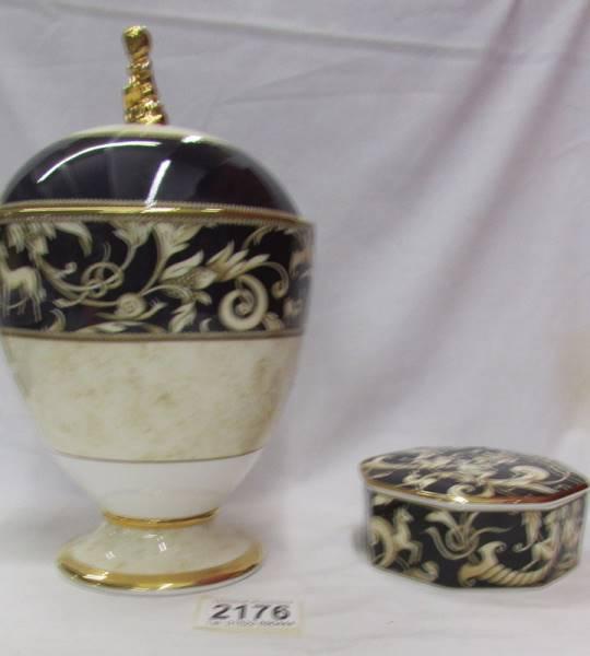 A Wedgwood 'Cornucopia' pattern lidded urn and a matching lidded pot.