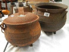 Two cast cauldrons (one has hole in bottom).
