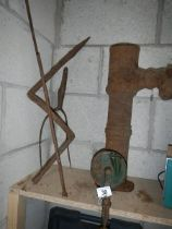 A cast garden pump and other metal ware.