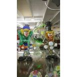 A glass fish and 2 glass clowns.