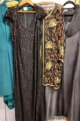 A collection of garments of varying designs and sizes including a heavily sequined jacket;