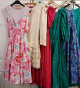Six vintage dresses (AF) of varying sizes and designs,
