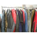 A full rail of vintage and other clothing.