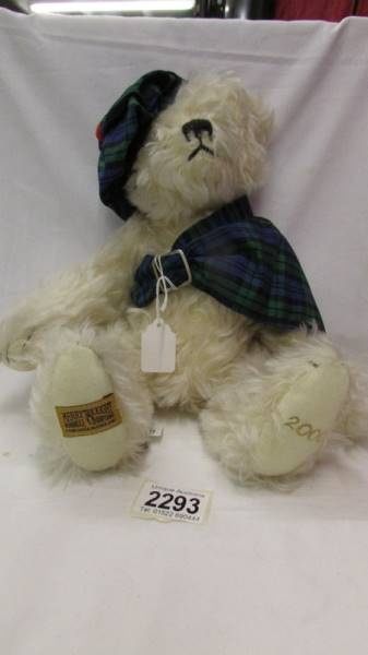 A limited edition Merrythought bear in Tartan hat and Scarf, with growler.
