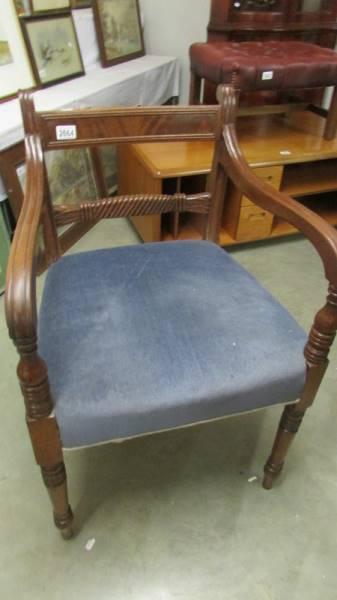 A mahogany elbow chair.