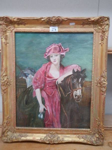 An oil on board study of a lady on a horse. 54 x 64 cm.