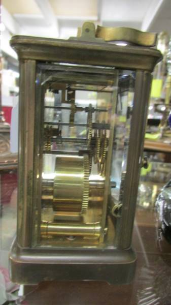 A brass carriage clock with key. - Image 2 of 2