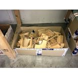 A box of wooden doll's furniture