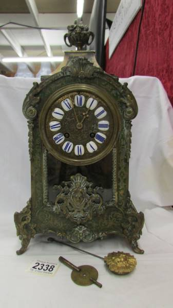 A Victorian Beulle mantel clock in good working order and in good condition with no lifting of