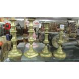 Two pairs of Victorian brass candlesticks.