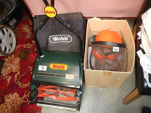 A good Webb manual mower, guard hat and other tools.