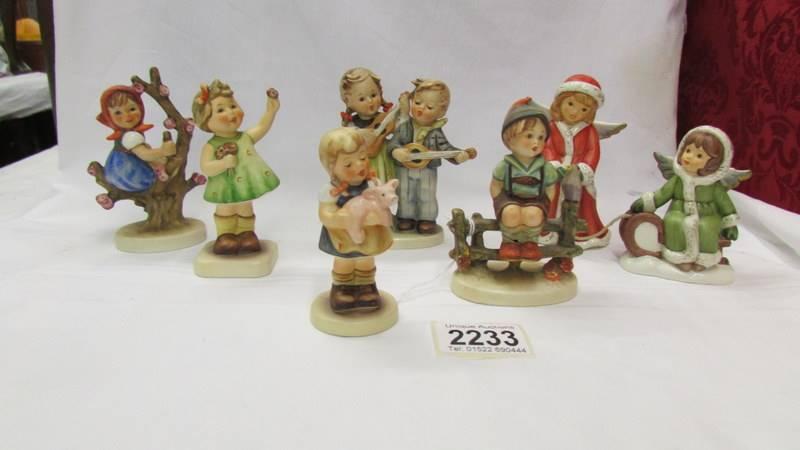 Siz Goebel/Hummel figurines.
