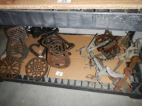 A good collection of pressed metal trivets etc.